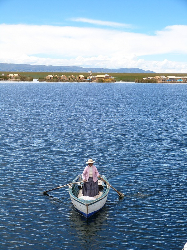 Local woman on a boat at the Floating Uros Islands of Lake Titicaca, Peru