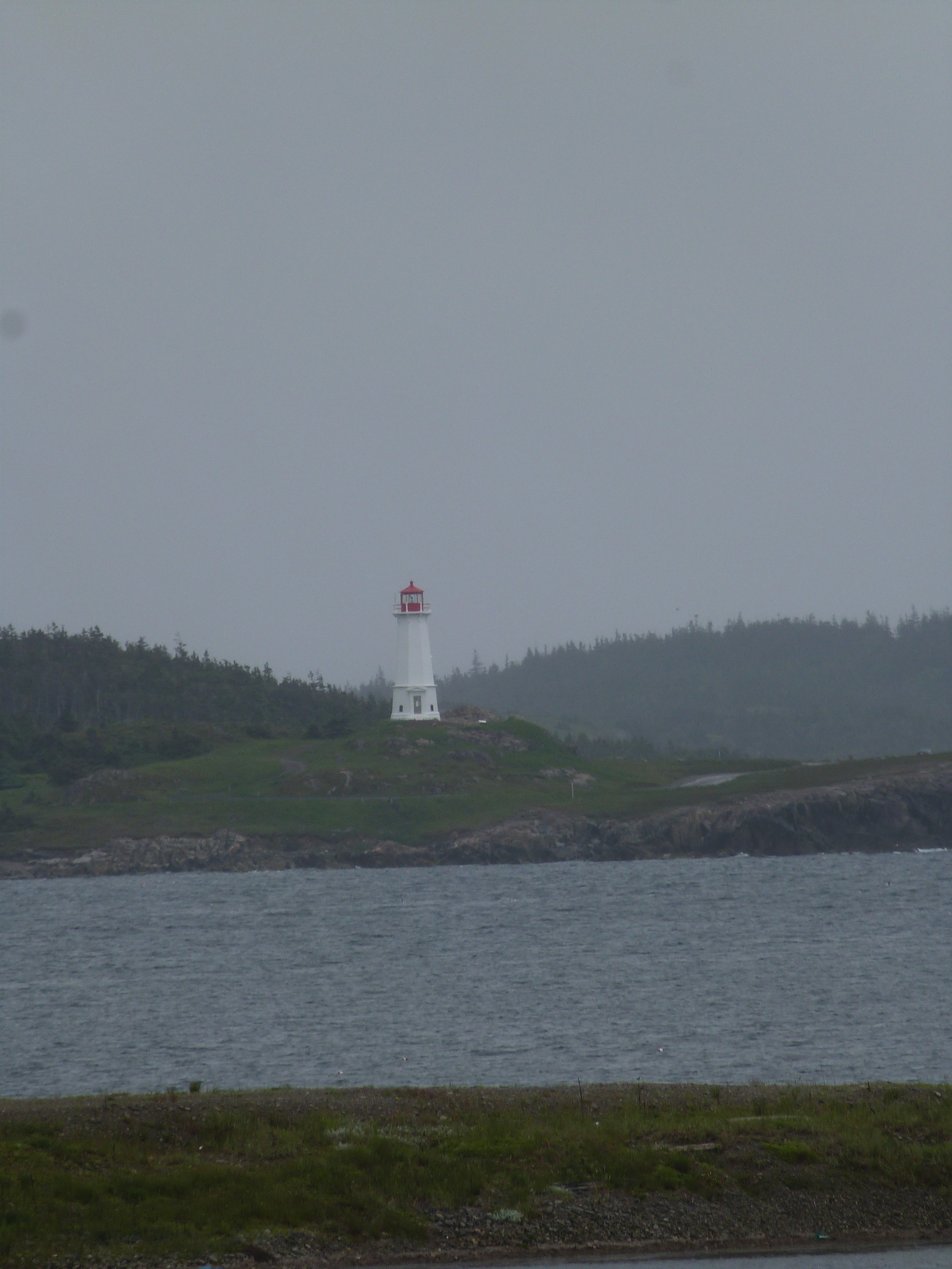 View to lighthouse from Fortress of Louisbourg on Cape Breton Island, Nova Scotia