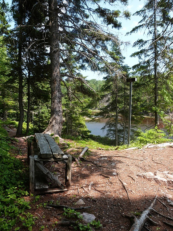 Hiking by a lake in Tadoussac, Quebec