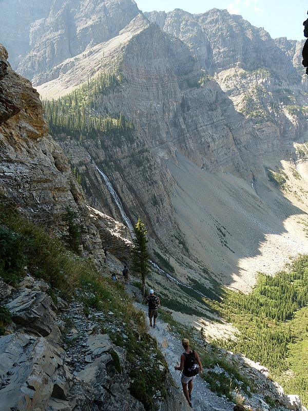 Edging along a cliffside path on the Crypt Lake Trail in Waterton Lakes National Park, Canada