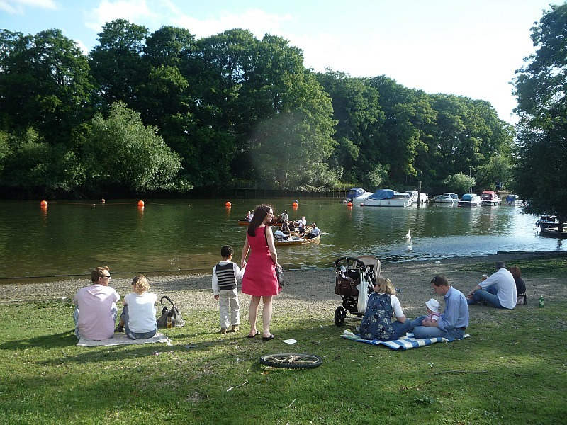 Picnicking by the riverside in Richmond in Greater London