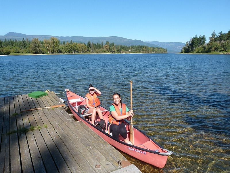 Canoeing on Shuswap River during our epic Canada on a budget trip