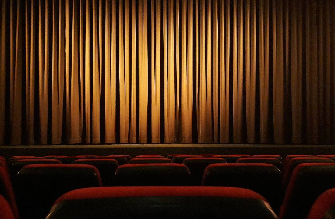 how to save money for travel - get discounted movie tickets