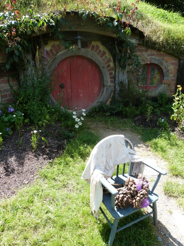 Outside a hobbit hole at Hobbiton New Zealand