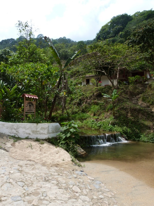 Swimming under waterfalls in Minca, Colombia - one of the 10 Best Offbeat Places in South America
