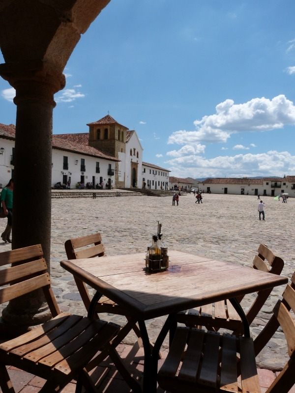 Relaxing in the main square of Villa de Leyva, Colombia