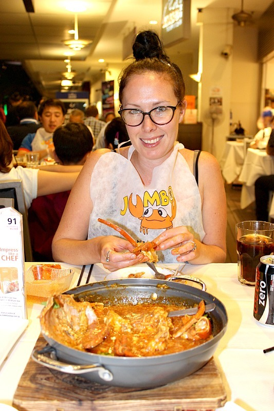 Eating chilli crab at famous Singapore Restaurant Jumbo