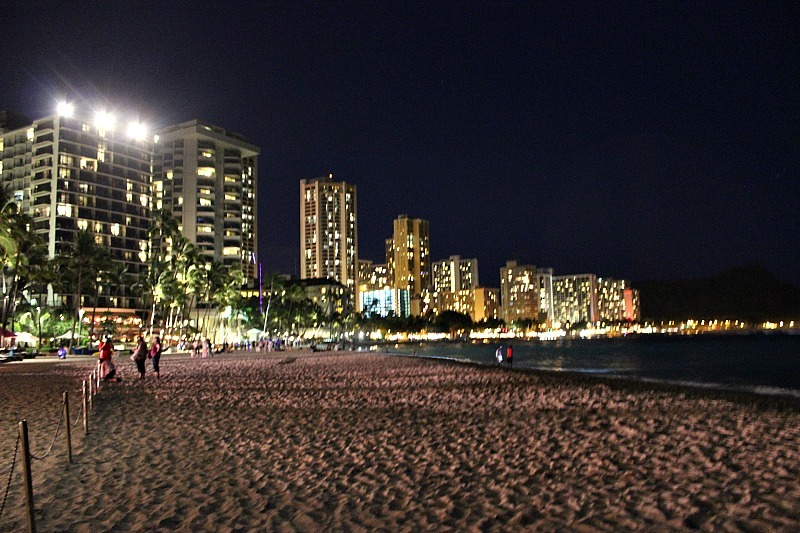 Walking Waikiki beach at night is one of the best things to do in Waikiki to escape the crowds