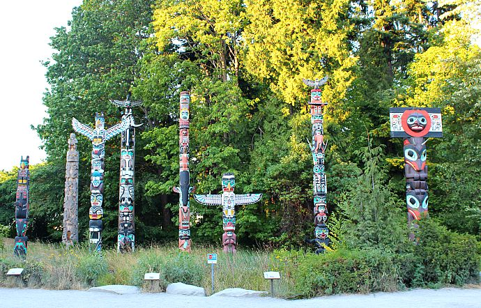 Totem poles in Stanley Park during summer in Vancouver