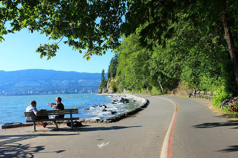 Walking the Sea wall in Stanley Park during summer in Vancouver