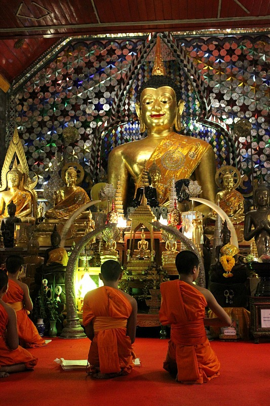 Buddhists praying in Chiang Mai during month five of digital nomad life