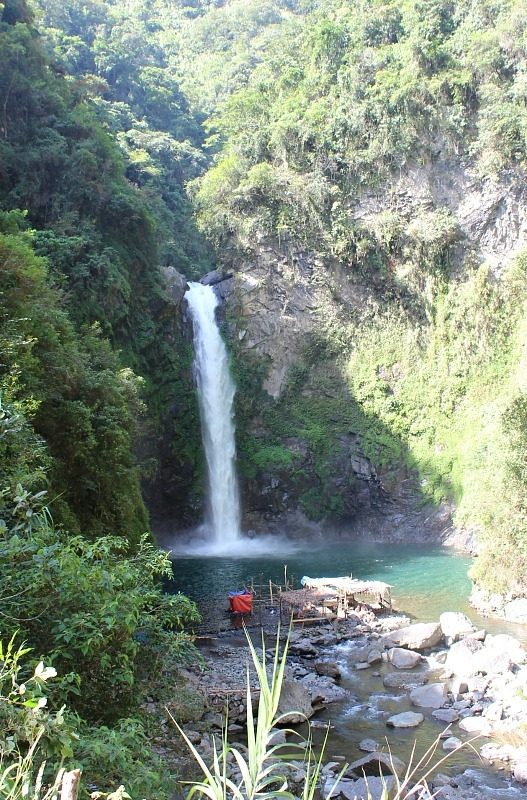 Swimming under a waterfall near Batad during month seven of digital nomad life