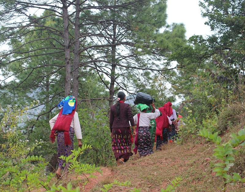 Local ladies hiking between villages during our trek to Inle lake from Kalaw