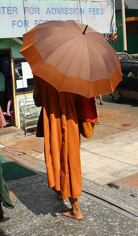 Monk with an umbrella in Yangon Myanmar
