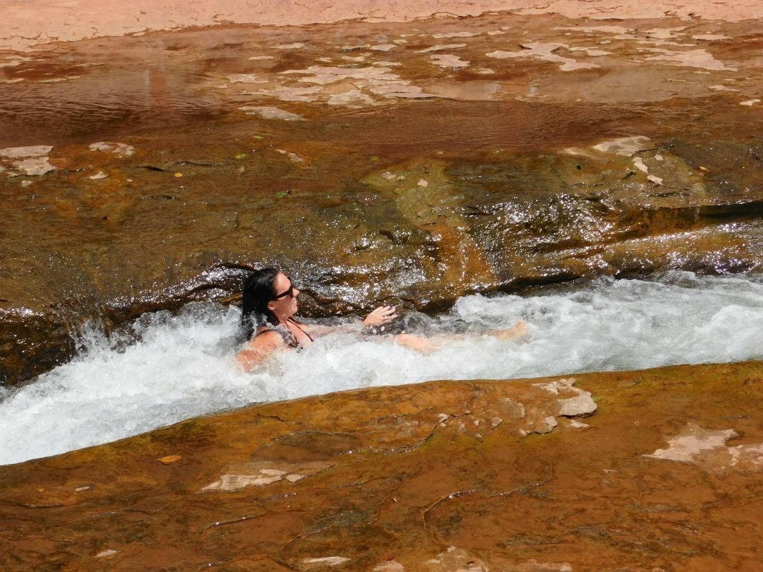 Sliding at Slide Rock State Park in Arizona during month 27 of digital nomad life