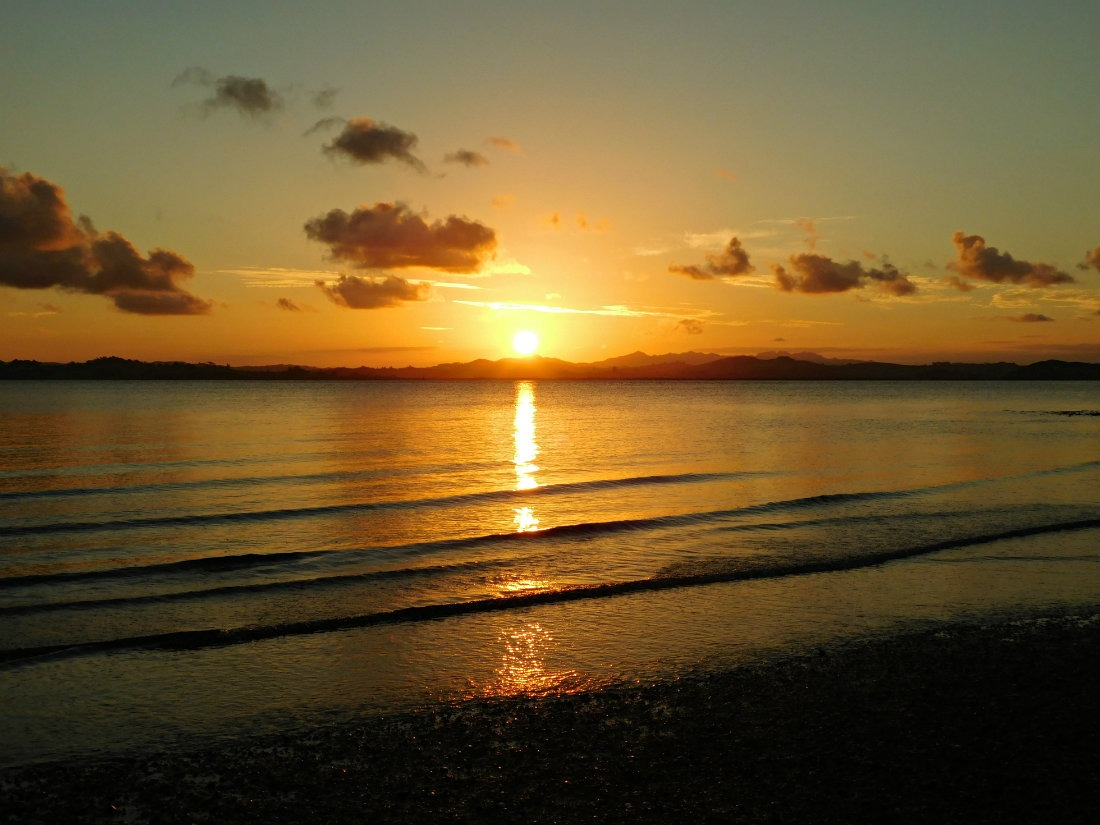 Sunset over Whangarei Heads during month thirty one of digital nomad life