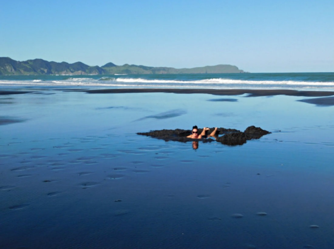 Natural hot springs at Kawhia Beach in New Zealand