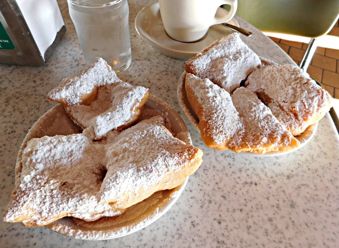 Eating beignets at Cafe Du Monde in New Orleans is the quintessential Louisiana food experience