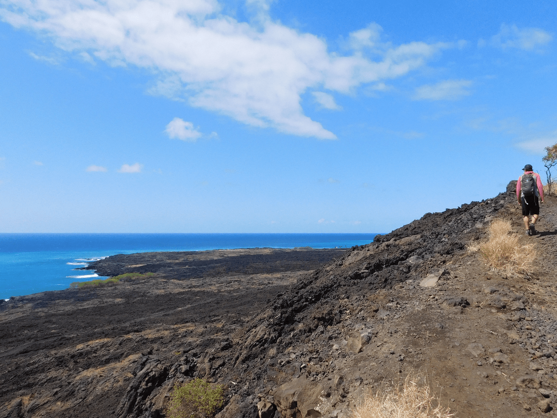 Hiking the Captain Cook Monument trail to go swimming with wild dolphins in Hawaii