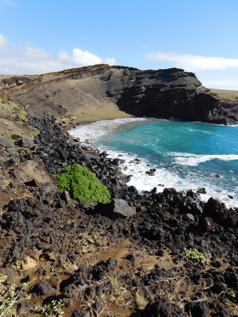 Hiking to the Green Sand Beach is a unique experience to add to your Big Island Hawaii Itinerary