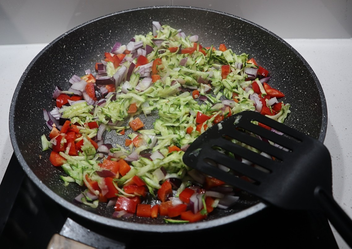 Saute vegetables for zucchini and corn fritters recipe