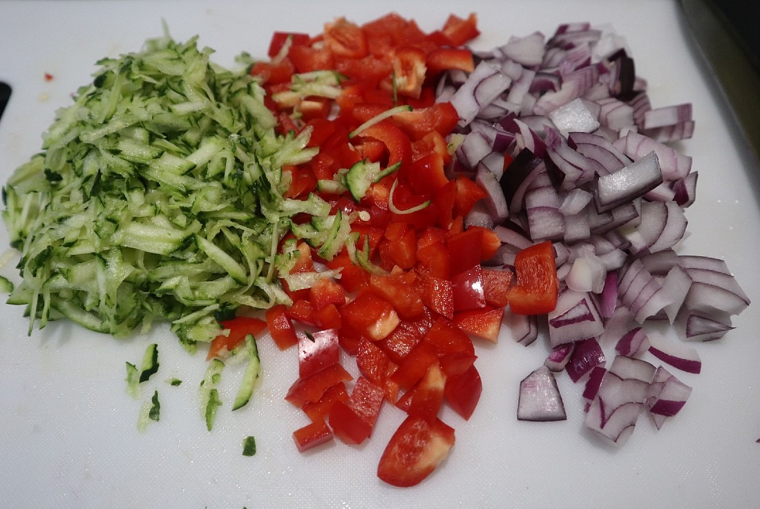 Chopped vegetables for Zucchini and Corn Fritters recipe
