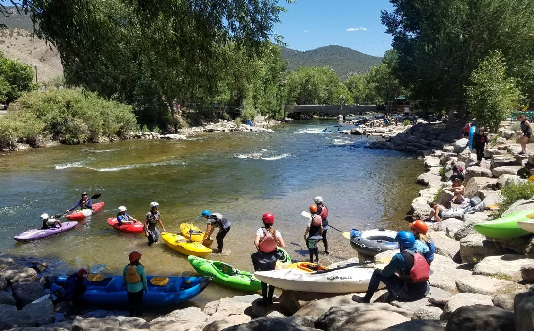 Kayakers on the river in Salida, one of the best mountain towns in Colorado
